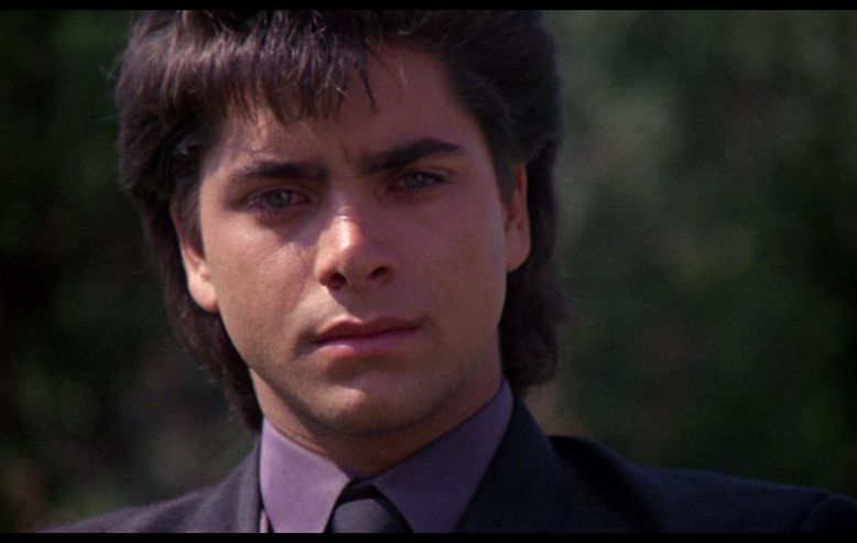 John Stamos in Never Too Young to Die